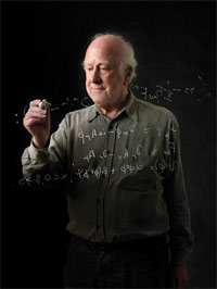 Peter Higgs seen writing equations